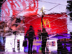 Circus Ghosts XXIX (Douguerreotype) Tags: uk gb britain british england london city urban night dark lights wet rain reflection colours people street piccadillycircus silhouette water weather
