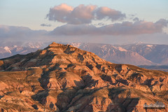 Badlands and Beartooths (kevin-palmer) Tags: mcculloughpeaksbadlands badlands cody wyoming april spring morning sunny sunshine nikond750 nikon180mmf28 telephoto early sunrise dawn beartoothmountains blm clouds gold golden