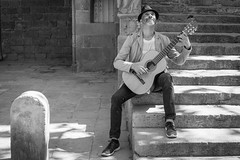 Serenaded... (Geraint Rowland Photography) Tags: serenade serenading guitar spanishguitarist spanishmusic streetperformer blancoynegro portrait streetportrait shadowsandlight summerinbarcelona visitbarcelona visitspain europe spanish catalonia musician talent steps stairs streetphotography geraintrowlandphotography wwwgeraintrowlandcouk