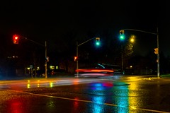 rainy night 2 (-liyen-) Tags: activeassignmentweekly aprilshowers rain night rainy wet trafficelight intersection suburban urban motionblur lighttrails fujixt1 bestofweek1