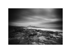 Dunstanburgh Castle (Furious Zeppelin) Tags: sea sky bw white black castle beach clouds nikon rocks long exposure northumberland le dunstanburgh d80 furiouszeppelin fz