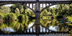 ....fishing on quiet waters....or perhaps dreaming reflections.... (Jordi AC) Tags: reflections fishing bridges dreaming