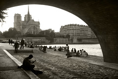 Music at sunset (R. O. Flinn) Tags: bridge musician paris france monochrome seine sepia river arch cathedral quay notredame