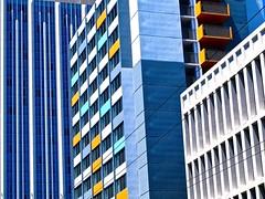 architectural abstract - (Explore!) (Demetrios Lyras) Tags: windows abstract building art colors architecture shadows angle fav50 south financialdistrict explore balconies soma sfist fav10 fav5 fav25 sanfranciscocausa fav75 anglesanglesangles