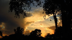 Evening storms and thundering sunset. (Jim Mullhaupt) Tags: blue sunset red wallpaper sky orange color weather silhouette yellow night clouds landscape spring nikon flickr afternoon florida dusk coolpix storms thunder bradenton sunray p510 mullhaupt jimmullhaupt
