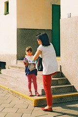 Praktica MTL 5 +  Helios 44-2 2/58 - Mother and Daughter in front of School (Kojotisko) Tags: street city people streets color vintage happy person czech streetphotography commons cc vintagecamera streetphoto persons praktica helios prakticamtl5 helios442258 prakticamtl colorhappy 200agfa 442heliosagfa colorexpiredbrnoczech republiccreative
