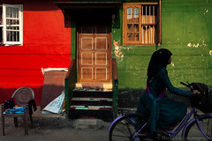Cycling, Mattancherry (Marji Lang Photography) Tags: life street travel light red people woman india house green colors bicycle silhouette composition contrast photography cycling colorful indian muslim streetphotography documentary streetlife streetscene kerala indians rue lightandshadow kochi inde southindia younggirl streetshot travelphotography photoderue southindian indiangirl 2013 mattancherry marjilang muslimindian