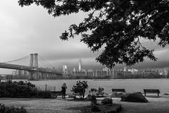 Waiting out the rain (BrianEden) Tags: city nyc bridge newyork storm rain weather brooklyn clouds rocks fuji unitedstates manhattan eastriver williamsburg fujifilm grandferrypark brianeden x100s