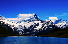 IMG_0327 (PS) (EastFB72) Tags: trip blue summer sky cloud mountain lake holiday reflection green wet water beauty grass season landscape switzerland europe swiss first peak adventure valley land grindelwald valais jungfrau swissalps bachalpsee allnaturesparadise
