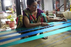 weaving blue (handheld-films) Tags: travel blue portrait people woman india female work indian documentary business portraiture weaver textiles weaving sari artisan madhyapradesh centralindia