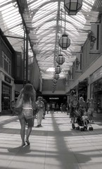 Shadows (4foot2) Tags: leica girls shadow blackandwhite bw sexy girl monochrome 35mm worthing legs negative 35mmfilm shoppingmall inside shorts analogue m3 hotgirl 50iso hotpants 2014 shpping sexygirl printfilm leicam3 polypanf polypanf50 4foot2 4foot2flickr 4foot2photostream fourfoottwo