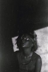 Mercury (Tamar Burduli) Tags: light shadow portrait blackandwhite woman sun sunlight film girl beautiful beauty glitter female analog vintage dark model eyes skin pentax room makeup scratches lips sensual soviet bones collarbones collars sovietfilm