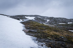Thaw (Serious Andrew Wright) Tags: norway rogaland lysebotn mountain snow ice cold rain cloud grey powerlines hills rock moss lichen landscape scenery road solitude