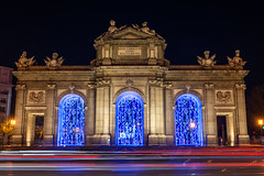 Illuminated Puerta de Alcalá in Christmas in Madrid (basair) Tags: alcala christmas traveldestinations alcalagate madrid europe monument spain architecture history travel tourism night gate multicolored illuminated blurredmotion horizontal famousplace spanishculture street townsquare citylife neoclassical nationallandmark europeanculture lights traffic longexposure door trails christmaslights road roundabout ancient landmark dark lighttrail plazadelaindependencia triumphalarch capitalcities city arch symbol cityscape stonematerial yellow red independence alcalastreet