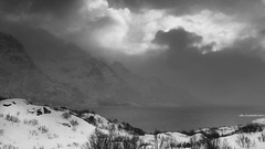 The angry elements of the North (lunaryuna) Tags: norway lofoten lofotenarchipelago lofotenislands austfjorden fjord seascape landscape sky clouds cloudscape weathermood blizzard mountainrange snow snowfall storm winter season seasonalwonders blackwhite bw monochrome panoramicviews lunaryuna