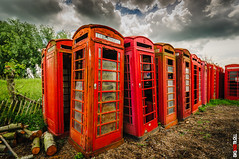 Telephone Graveyard (BigRedTroll) Tags: british business color communication decay decayed decaying grunge grungy red telephone telephonebox threatening