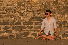 Hipster Yogis can only be seen during Sunsets (jackparrot0) Tags: yoga yogi pose chill relax relaxed stare sunglasses man crossed legs meditation wall stone bricks sunset nuances beach sand shirt shorts profile portrait summer hipster