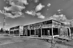 Closed (Len Langevin) Tags: abandoned old building gasstation derelict forgotten closed graffiti monochrome blackandwhite alberta canada nikon d300s tokina 1116