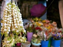 flower and candle vendors (DOLCEVITALUX) Tags: lumixlx100 panasoniclumixlx100 flowers flower candle child sleeping streetscenes streetphotoshoot philippines manila jasmine sampaguita