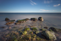 Rocky Seascape III (Normann Photography) Tags: 300sec 5minutes exxonoilrefinery leefilters skallevold skallevoll beautifulday blue bluesky green rocky seascape shore sunshine superstopper water tønsberg vestfold norway no