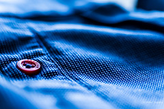 Premium (Peter Jaspers (on/off)) Tags: frompeterj© 2017 olympus omd zuiko em10 1240mm28 macro macromondays cloth textile button red knoop katoen cotton shirt home dof hmm clothtextile bokeh premium