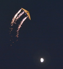 HANG GLIDER DAN BUCHANAN IS A LICENSED PYROTECHNICIAN AND IT HAS TAKEN HOURS OF PREPARATION (ON HIS GLIDER AND HIMSELF), TO PUT ON SUCH A WONDERFUL VISUAL PERFORMANCE AT THE ABBOTSFORD AIRSHOW,  BC. (vermillion$baby) Tags: abbotsfordairshow danbuchanan eveningshow fraservalley airplane airshow airshow1 blue f fireworks flickr glider kite nightshot parachute sky light moon firework fireworkslightnightshot nightshow night fireworkf