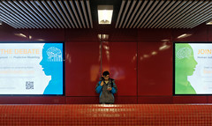 to join or not to join the debate? (hugo poon - one day in my life) Tags: x100f hongkong central mtr centralstation colours solitude debate phone browse waiting sign
