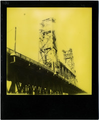 Steel Bridge (R. Drozda) Tags: portland oregon steelbridge willametteriver pdx polaroid impossibleproject yellowduochrome thirdmanrecordsedition instantfilm bridge yellow black infrastructure drozda