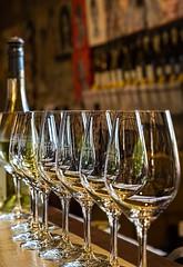 Waiting to Taste (docoverachiever) Tags: stemware france shiny tastingroom provence domainedelapresidente winery indoors glasses wine row bottle