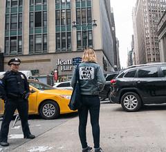 Hear Our Voice (UrbanphotoZ) Tags: hearourvoice woman denim jacket back april15 trump showusyourtaxes march policeofficer policeman cop taxi traffic jean hair westside midtown manhattan newyorkcity newyork nyc ny officebuilding