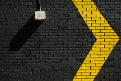 To the right (The Green Album) Tags: right direction arrow yellow black bricks abstract danger high voltage paint cardiff urban street fujifilm xt2