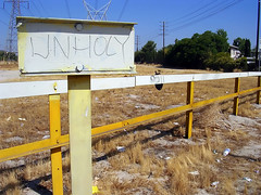 Unholy (See El Photo) Tags: california ca city trees sky urban brown color colour building grass lines sign yellow cali apt trash digital fence word outside outdoors wire weeds nikon colorful day colore power apartment noho ground dirty pole litter powerlines dirt signage bolts daytime telephonepole couleur tumbleweed bule feild northhollywood unholy e3200