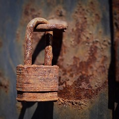 Remember to lock up your valuables. (coeyson) Tags: street stilllife abstract macro abandoned monochrome rural vintage square alley rust lock rusty minimal textures americana minimalism groovy corroded