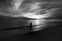 believe in me (Bec .) Tags: ocean light sunset bw woman reflection water silhouette clouds canon walking sand adelaide southaustralia 1022mm henleybeach 10mm believeinme 450d rbat75