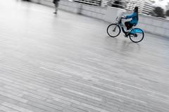 Racing Line (John Fÿn Photography) Tags: uk blue england urban woman london bike europe unitedkingdom riding selectivecolour diagonals photo24 photo24london