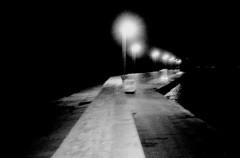 the jetty (asketoner) Tags: summer italy blur car night dark italia harbour jetty depth puglia manfredonia