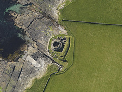 Midhowe broch, Rousay, Orkney Islands 2009 (Historic Environment Scotland) Tags: canmore rcahms hes historicenvironmentscotland scotland broch aerial aerialphotograph archaeology prehistoric ironage monument green dp059707 midhowe rousay 2009
