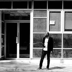 In front of the doors and windows (pascalcolin1) Tags: paris13 homme man fenetres windows portes doors lumière light carré square photoderue streetview urbanarte noiretblanc blackandwithe photopascalcolin