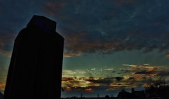 east of elva... (BillsExplorations) Tags: east grainstorage grainelevator silo elevator grain agriculture sunset sky clouds illinois abandoned decay ruraldecay railroad tracks ghosts elva forgotten closed old silhouette