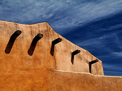 Adobe and Vigas (studioferullo) Tags: abstract architecture art beauty bright building colorful colors contrast dark design detail edge house light minimalism natural outdoor outside perspective pattern pretty scene serene tranquil shadow sky study sunlight sunshine texture tone weathered world tucson arizona adobe stucco plaster viga lines diagonal cloud blue brown ocher ochre tohonochul park wall wood timber
