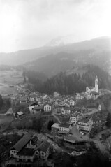 04a3571 23 (ndpa / s. lundeen, archivist) Tags: nick dewolf nickdewolf bw blackwhite photographbynickdewolf film monochrome blackandwhite april 1971 1970s 35mm europe centraleurope switzerland swiss alpine alps graubünden grisons easternswitzerland suisse schweitz mountains swissalps ontheroad roadtrip town village tiefencastel building buildings church tower kirch kirchststefan ststephenchurch ststefan river albula hotel hotels posthotel julier hoteljulier posthoteljulier hill hilltop hotelalbula landscape street road highway car cars vehicle vehicles automobile automobiles bus house houses home homes streets hillside