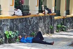 Lunch hour (Roving I) Tags: workers workmen snooze sleep fences stone footpaths barefeet facemasks danang vietnam