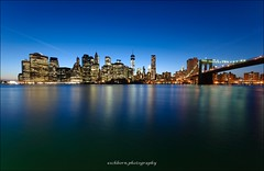 New York City Downtown Sunset Skyline (eschborn.photography) Tags: world new york city trip bridge vacation usa ny west tower water brooklyn reflections river dark lights one freedom 1 evening downtown side nj center east single trade 2014 eschborn eschbornphotography