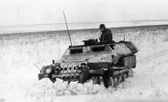 half track pushing the snow before it. Russian front.