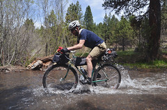 Ryan in one of the many Trout Creek water crossings (gabriel amadeus) Tags: camping bike oregon ride mtb outback touring gravel oregonoutback bikepacking