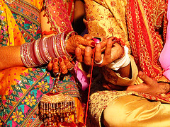 Indian Couple at wedding (atitsince82) Tags: life wedding red portrait flower color love thread closeup happy bride holding hands colorful dress indian union praying ceremony marriage husband rope clothes celebration wife bond string holdinghands bridegroom saree bangles kurta joining ilobsterit