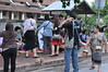 A motley mix of the faithful and tourists (shankar s.) Tags: southeastasia earlymorning buddhism tourists lp laos luangprabang buddhistmonk laopdr makingmerit unescoworldheritagecity buddhistreligion takbat buddhistfaith morningalmsgivingritualluangprabang morningalmsgivinginluangprabang