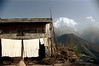 21-414 (ndpa / s. lundeen, archivist) Tags: nepal houses sky color building film clouds rural 35mm village view 21 nick peak vista nepalese clothesline peaks 1970s 1972 himalayas snowcovered nepali dewolf mountainvillage ruralvillage annapurnasouth hiunchuli nickdewolf photographbynickdewolf ruralnepal reel21 hillyregion