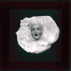 Ectoplasm (Tyne & Wear Archives & Museums) Tags: test face photography weird scary model doll spirit ghost experiment fake makeup surreal artificial eerie creepy odd unusual striking paranormal psychic spiritphotography 1934 fraud lecturer physical supernatural ectoplasm phenomena flowerpetals showpiece blankexpression blackandwhitephotograph lanternslides myseterious anewangle lecturepresentation mrcpmaccarthy