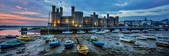 Caernarfon Castle - Caernarfon, Wales (dejott1708) Tags: caernarfon castle blue hour night shot long exposure panorama landscape cityscape wales great britain low tide harbour